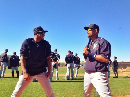 Endy Chavez and Franklin Gutierrez share a laugh before heading to the outfield.