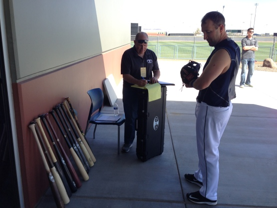Willie Bloomquist checks out the Trinity Bats selection.