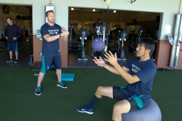 Kuma working with James Clifford in the weight room.