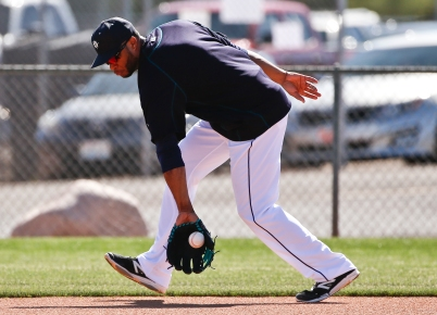 Robinson Cano fielding grounders in morning workouts.