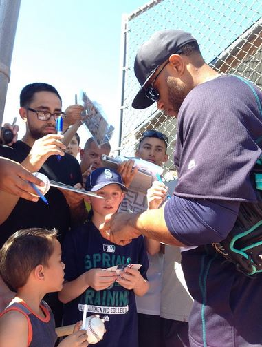 Robinson Cano signs after taking BP.