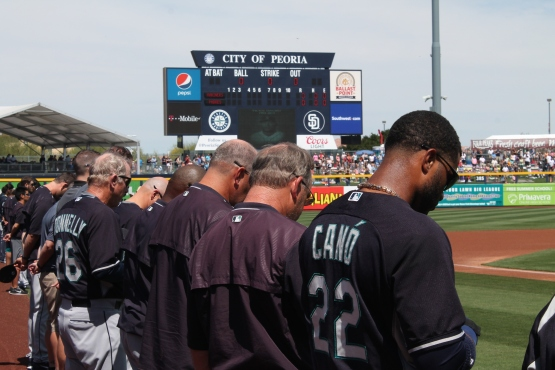 The Mariners during a moment of silence for Victor Sanchez.