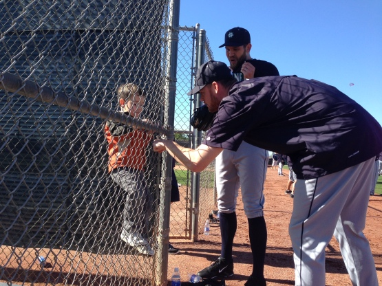 Tom Wilhelmsen and Charlie Furbush find a friend during workouts.