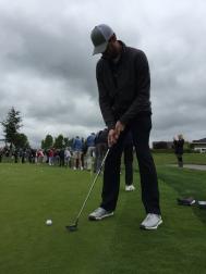 Charlie Furbush lining up a putt.