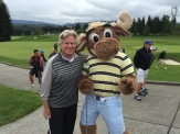 Longtime Seattle news anchor Dan Lewis with the Mariner Moose.