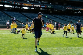 Pitcher Charlie Furbush gets kids moving during the PLAY event at Safeco Field.