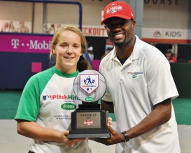Haley Loffer receives her Second Place plaque from Harold Reynolds in the Pitch, Hit and Run National Finals in Cincinnati.