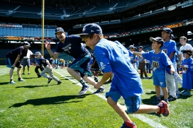 Pitcher James Paxton puts kids through their paces during the PLAY event at Safeco Field.