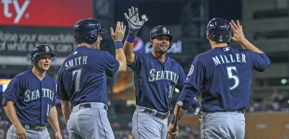 Guti celebrates with teammates after hitting a grand slam vs. the Tigers. (Photo: Leon Halip/Getty Images)
