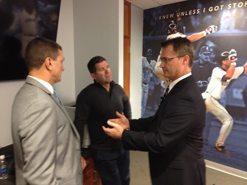 Manager Scott Servais (R), chats with Tim Bogar (L) & Edgar Martinez (C) prior to today's news conference.