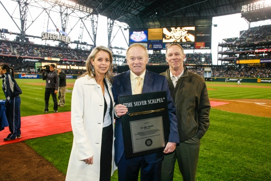 "Dr. Larry Pedegana, who was the Mariners team physician from 1977-2006, was presented with a ""Silver Scalpel"" award on Opening Day 2006."