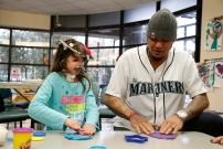 Felix Hernandez with a young patient in the Seattle Children's Hospital playroom.