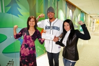 Felix and Sandra Hernandez (right) present a $10,000 grant to the Seattle Children's Hospital Strong Against Cancer initiative.