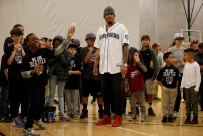 Kids at Rainier Vista Boys & Girls Club get pitching tips from Mariners ace Felix Hernandez.