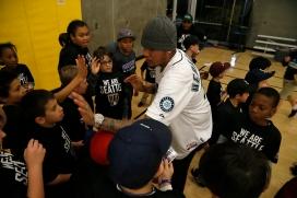 Reviving Baseball in Inner Cities participants get high fives from Felix Hernandez at the Rainier Vista Boys & Girls Club.
