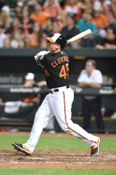 BALTIMORE, MD - SEPTEMBER 11: Steve Clevenger #45 of the Baltimore Orioles hits a grand slam in the eight inning during a baseball game against the Kansas City Royals at Oriole Park at Camden Yards on September 11, 2015 in Baltimore, Maryland. The Orioles on 14-8. (Photo by Mitchell Layton/Getty Images)
