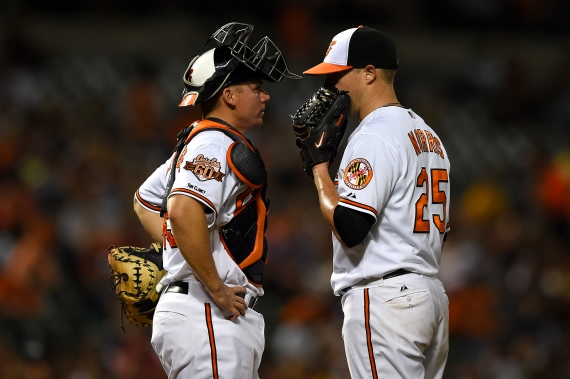 BALTIMORE, MD - MAY 12: Pitcher Bud Norris #25 of the Baltimore Orioles and catcher Steve Clevenger #45 of the Baltimore Orioles talk to one another in the fifth inning against the Detroit Tigers at Oriole Park at Camden Yards on May 12, 2014 in Baltimore, Maryland. The Detroit Tigers won, 4-1. (Photo by Patrick Smith/Getty Images)
