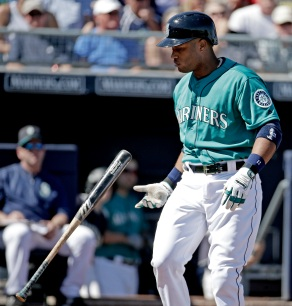 Seattle Mariners' Robinson Cano flips his bat after striking out during the first inning of a spring training baseball game against the Kansas City Royals, Wednesday, March 9, 2016, in Peoria, Ariz. (AP Photo/Charlie Riedel)