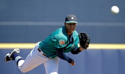 Seattle Mariners starting pitcher Taijuan Walker throws during the first inning of a spring training baseball game against the Kansas City Royals, Wednesday, March 9, 2016, in Peoria, Ariz. (AP Photo/Charlie Riedel)