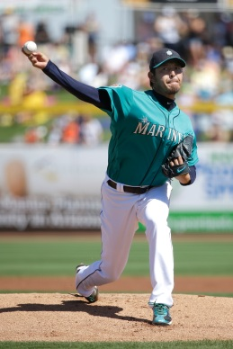 Seattle Mariners starting pitcher Hisashi Iwakuma, of Japan, throws against the San Francisco Giants during the first inning of a spring training baseball game, Wednesday, March 16, 2016, in Peoria, Ariz. (AP Photo/Jae C. Hong)