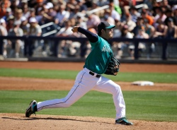 Seattle Mariners starting pitcher Hisashi Iwakuma, of Japan, throws against the San Francisco Giants during the third inning of a spring training baseball game Wednesday, March 16, 2016, in Peoria, Ariz. (AP Photo/Jae C. Hong)