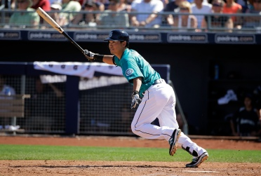 Seattle Mariners' Norichika Aoki, of Japan, watches his single during the third inning of a spring training baseball game against the San Francisco Giants on Wednesday, March 16, 2016, in Peoria, Ariz. (AP Photo/Jae C. Hong)