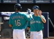 Seattle Mariners' Luis Sardinas, left, celebrates his two-run home run with Norichika Aoki, of Japan, during the third inning of a spring training baseball game against the San Francisco Giants on Wednesday, March 16, 2016, in Peoria, Ariz. (AP Photo/Jae C. Hong)