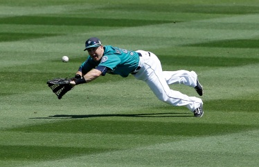 Seattle Mariners' Dan Robertson cannot catch a triple hit by San Diego Padres' Melvin Upton Jr. during the fourth inning of a spring training baseball game in Peoria, Ariz., Wednesday, March 30, 2016. (AP Photo/Jeff Chiu)