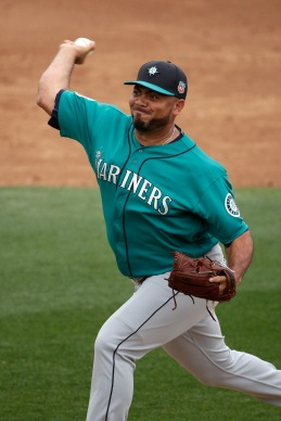 Seattle Mariners relief pitcher Joaquin Benoit throws during the third inning of a spring training baseball against the Texas Rangers game Sunday, March 6, 2016, in Surprise, Ariz. (AP Photo/Charlie Riedel)