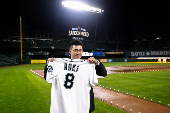 Seattle Mariners outfielder Nori Aoki poses with a jersey Thursday, Dec. 3, 2015, in Seattle. (AP Photo/Joe Nicholson)