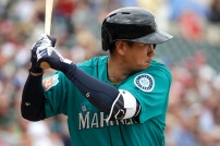 Seattle Mariners' Dae Ho Lee bats during the first inning of a spring training baseball game against the Texas Rangers Sunday, March 6, 2016, in Surprise, Ariz. (AP Photo/Charlie Riedel)