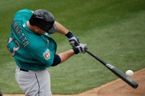 Seattle Mariners' Chris Iannetta bats during the third inning of a spring training baseball against the Texas Rangers game Sunday, March 6, 2016, in Surprise, Ariz. (AP Photo/Charlie Riedel)