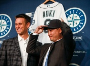 Seattle Mariners outfielder Nori Aoki, right, poses for a photo with general manager Jerry Dipoto during a news conference Thursday, Dec. 3, 2015, in Seattle. Aoki will primarily be a left fielder for Seattle, but will move around as part of a five-man rotation including Seth Smith, Franklin Gutierrez, Leonys Martin and Nelson Cruz. (AP Photo/Joe Nicholson)