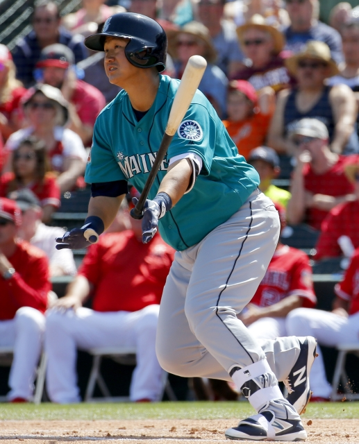 Seattle Mariners' Dae-Ho Lee follows through on an RBI base hit against the Los Angeles Angels during the first inning of a spring training baseball game, Tuesday, March 15, 2016, in Tempe, Ariz. (AP Photo/Matt York)
