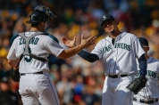 SEATTLE, WA - SEPTEMBER 28: Starting pitcher Felix Hernandez #34 of the Seattle Mariners is congratulated by catcher Mike Zunino #3 after being removed from the game against the Los Angeles Angels of Anaheim in the sixth inning at Safeco Field on September 28, 2014 in Seattle, Washington. (Photo by Otto Greule Jr/Getty Images)