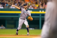 DETROIT, MI - AUGUST 16: Chris Taylor #1 of the Seattle Mariners throws to first base during the game against the Detroit Tigers at Comerica Park on Saturday, August 16, 2014 in Detroit, Michigan. (Photo by Rey Del Rio/MLB Photos via Getty Images)