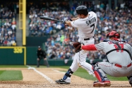SEATTLE, WA - APRIL 06: Seth Smith #7 of the Seattle Mariners hits an RBI double in the fifth inning against the Los Angeles Angels of Anaheim during the home opener at Safeco Field on April 6, 2015 in Seattle, Washington. (Photo by Otto Greule Jr/Getty Images)