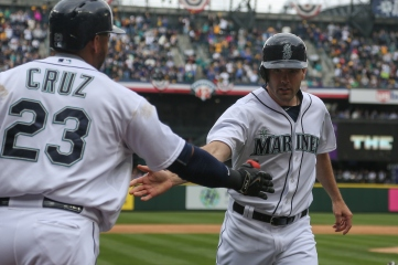SEATTLE, WA - APRIL 06: Seth Smith #7 of the Seattle Mariners is congratulated by Nelson Cruz #23 after scoring in the third inning against the Los Angeles Angels of Anaheim during the home opener at Safeco Field on April 6, 2015 in Seattle, Washington. Smith had three hits as the Mariners defeated the Angels 4-1. (Photo by Otto Greule Jr/Getty Images)