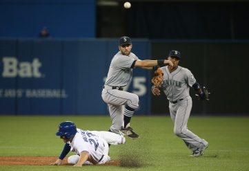 TORONTO, CANADA - MAY 22: Chris Taylor #1 of the Seattle Mariners turns a double play as Robinson Cano #22 looks on in the fifth inning during MLB game action as Danny Valencia #23 of the Toronto Blue Jays slides into second base on May 22, 2015 at Rogers Centre in Toronto, Ontario, Canada. (Photo by Tom Szczerbowski/Getty Images) *** Local Caption *** Chris Taylor; Robinson Cano; Danny Valencia