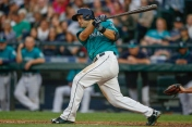 SEATTLE, WA - JULY 10: Jesus Montero #63 of the Seattle Mariners singles in the fourth inning against the Los Angeles Angels of Anaheim at Safeco Field on July 10, 2015 in Seattle, Washington. (Photo by Otto Greule Jr/Getty Images)