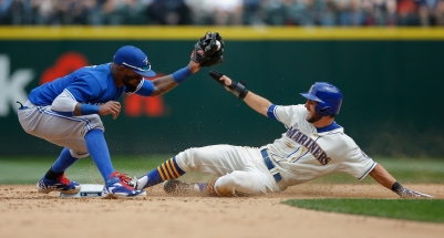 SEATTLE, WA - JULY 26: Chris Taylor #1 of the Seattle Mariners is forced out at second base on a fielders choice by shortstop Jose Reyes #7 of the Toronto Blue Jays in the sixth inning at Safeco Field on July 26, 2015 in Seattle, Washington. (Photo by Otto Greule Jr/Getty Images)
