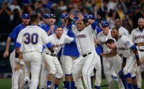 SEATTLE, WA - JULY 26: Franklin Gutierrez #30 of the Seattle Mariners is congratulated by teammates after hitting a walk-off home run to defeat the Toronto Blue Jays 6-5 in ten innings at Safeco Field on July 26, 2015 in Seattle, Washington. (Photo by Otto Greule Jr/Getty Images)