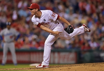 PHILADELPHIA, PA - AUGUST 04: Justin De Fratus #30 of the Philadelphia Phillies delivers a pitch in the sixth inning against the Los Angeles Dodgers at Citizens Bank Park on August 4, 2015 in Philadelphia, Pennsylvania. (Photo by Drew Hallowell/Getty Images)