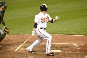 BALTIMORE, MD - AUGUST 17: Steve Clevenger #45 of the Baltimore Orioles takes a swing in the eighth inning during a baseball game against the Oakland Athletics at Oriole Park at Camden Yards at on August 17, 2015 in Baltimore, Maryland. The Orioles won 4-2. (Photo by Mitchell Layton/Getty Images)