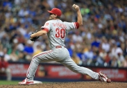 MILWAUKEE, WI - AUGUST 15: Justin De Fratus #30 of the Philadelphia Phillies pitches during the seventh inning of their game against the Milwaukee Brewers at Miller Field on August 15, 2015 in Milwaukee, Wisconsin. The Brewers defeated the Phillies 4-2. (Photo by John Konstantaras/Getty Images)