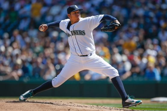 SEATTLE, WA - AUGUST 26: Starting pitcher Felix Hernandez #34 of the Seattle Mariners pitches in the third inning against the Oakland Athletics at Safeco Field on August 26, 2015 in Seattle, Washington. (Photo by Otto Greule Jr/Getty Images)