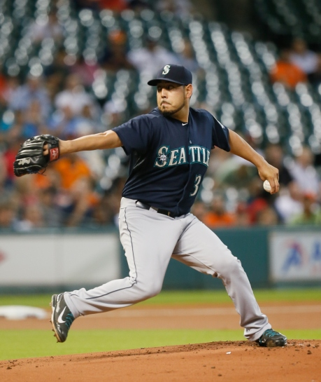 HOUSTON, TX - AUGUST 31: Vidal Nuno #38 of the Seattle Mariners throws in the first inning against the Houston Astros at Minute Maid Park on August 31, 2015 in Houston, Texas. (Photo by Bob Levey/Getty Images)