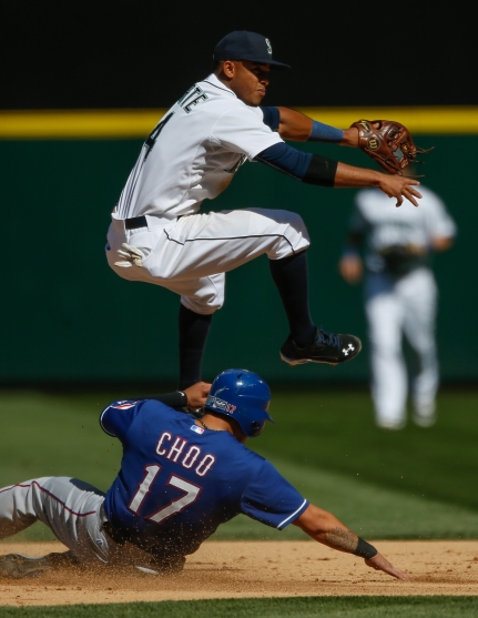 SEATTLE, WA - SEPTEMBER 10: Ketel Marte #4 of the Seattle Mariners turns a double play over Shin-Soo Choo #17 of the Texas Rangers at second base in the sixth inning at Safeco Field on September 10, 2015 in Seattle, Washington. The Mariners defeated the Rangers 5-0. (Photo by Otto Greule Jr/Getty Images)