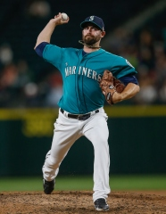 SEATTLE, WA - SEPTEMBER 11: Relief pitcher Tony Zych #55 of the Seattle Mariners pitches against the Colorado Rockies in the ninth inning at Safeco Field on September 11, 2015 in Seattle, Washington. (Photo by Otto Greule Jr/Getty Images)