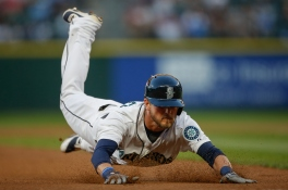 SEATTLE, WA - SEPTEMBER 12: Shawn O'Malley #36 of the Seattle Mariners dives into third on a single and throwing error in the fourth inning against the Colorado Rockies at Safeco Field on September 12, 2015 in Seattle, Washington. (Photo by Otto Greule Jr/Getty Images)